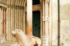 Cathedral,Torre Civica and Piazza Grande, Modena - Modena Cathedral: A lion statue support a column of the Porta Regia, the Royal Gate. The Royal Gate was decorated by Anselmo da Campione and his...