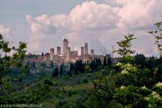 Historic Centre of San Gimignano - San Gimignano rises on top of a hill, 334 metres above sea level. The 14 medieval towers of San Gimignano are clearly visible from a...