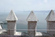 Tower of Belém - The 25 de Abril Bridge seen from the Tower of Belém, a 16th century tower in Lisbon, built on a small island in the Tagus...