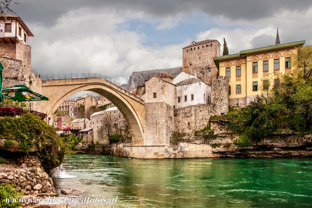 Old City of Mostar - Old Bridge Area of the Old City of Mostar: The green tinted waters of the Neretva River flows beneath the Old Bridge of Mostar, the Stari Most....