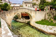 Old City of Mostar - Old Bridge Area of the Old City of Mostar: The Crooked Bridge (Kriva Cuprija) is a tiny stone arch bridge and looks like a miniature version of...