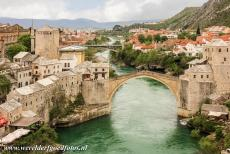 Old City of Mostar - Old Bridge Area of the Old City of Mostar: The Old Bridge and its two towers, the Mostari. The Old Bridge of Mostar (Stari Most) spans the...