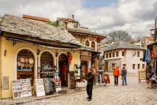 Old City of Mostar - The Tepa Market in the Old Bridge Area of the Old City of Mostar. The streets of the Old City of Mostar are paved with...