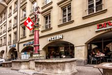 Old City of Bern - Old City of Bern: The Ryffli Fountain and the famous arcades in the Aarbergergasse street. The Ryffli Fountain (German:...