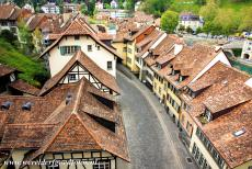 Old City of Bern - A cobbled street lined with medieval houses in the Old City of Bern seen from the Münster Platform, the Minster Terrace. The...