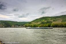 Upper Middle Rhine Valley - Upper Middle Rhine Valley: A cargo boat on Rhine near Lorch am Rhein, once the capital city of the former Free State Bottleneck. For two millennia...