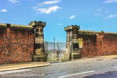 Liverpool - Mercantile City - Liverpool - Maritime Mercantile City: The impressive Dock Wall and the main entrance gate into Clarence Dock. The wall was built of red...