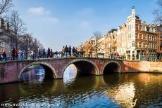 Canal Ring Area of Amsterdam - Seventeenth-century Canal ring area of Amsterdam inside the Singelgracht: An arched stone bridge crossing the Keizersgracht, one of the main...
