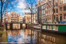 Canal Ring Area of Amsterdam - A houseboat in one of the canals of Amsterdam. Many people in Amsterdam are living on a houseboat. After World War II,...