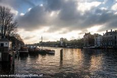 Canal Ring Area of Amsterdam - Dark clouds looming over the canals of Amsterdam. The Seventeenth-century Canal ring area of Amsterdam inside the Singelgracht...