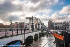 Canal Ring Area of Amsterdam - Seventeenth-century Canal Ring Area of Amsterdam inside the Singelgracht: The Magere Brug (Skinny Bridge) is one of the most famous bridges...