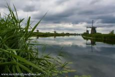 Mill Network at Kinderdijk-Elshout - The Mill Network at Kinderdijk-Elshout is surrounded by water and reeds. The windmill is a symbol of the Netherlands and their fight...