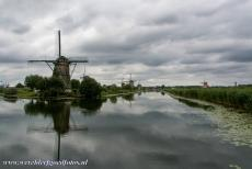 Mill Network at Kinderdijk-Elshout - Dark clouds looming over the nineteen windmills at Kinderdijk-Elshout. The Mill Network at Kinderdijk-Elshout was built to drain the...