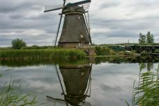 Mill Network at Kinderdijk-Elshout - A windmill mirroring on the water surface. A footpath along the canal offers amazing views of the 19 monumental windmills at...