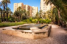 Palmeral of Elche - A cascade fountain in the Palmeral of Elche, the city of Elche in the background. The Palmeral is situated in the heart of...