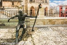 Route of Santiago de Compostela in Spain - Route of Santiago de Compostela in Spain:  A Bronze statue of an exhausted pilgrim outside Burgos Cathedral. Burgos is located...