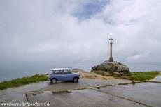 Route of Santiago de Compostela in Spain - Route de Santiago de Compostela in Spain: Our classic mini, a 1974 Mini Authi. in front of the stone cross at Cape Finisterre....