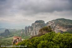 Monasteries of Meteora - The Monasteries of Meteora perched on the rocks. In the 14th century, Greece was ruled by the Ottoman Empire, many monks found a...