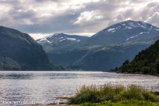 Geirangerfjord and Nærøyfjord - West Norwegian Fjords - Geirangerfjord and Nærøyfjord: The snow-covered mountains around the Geirangerfjord. The amazing...