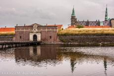 Kronborg Castle - Kronborg Castle is surrounded by a deep moat. The way into the castle passes through the Dark Gate, a dark and long tunnel-like...