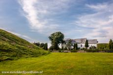 Jelling Mounds, Runic Stones and Church - Jelling Mounds, Runic Stones and Church: The present church was built in the Romanesque style in 1100.  The Jelling Mounds, the Runic...