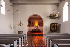 Jelling Mounds, Runic Stones and Church - Jelling Mounds, Runic Stones and Church: The simply furnished interior of the Jelling Church. In 2000, after extensive study at the National...