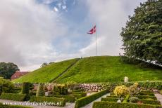 Jelling Mounds, Runic Stones and Church - Jelling Mounds, Runic Stones and Church: The south mound at Jelling. The Royal Standard of Denmark is raised on the Jelling Mounds every summer...