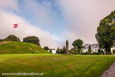 Jelling Mounds, Runic Stones and Church - Jelling Mounds, Runic Stones and Church: The Royal Standard of Denmark is raised on the Jelling Mounds every summer Sunday because the Jelling...