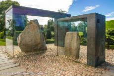 Jelling Mounds, Runic Stones and Church - Jelling Mounds, Runic Stones and Church: The smallest and oldest runestone was raised by the Danish King Gorm the Old in memory of his wife...