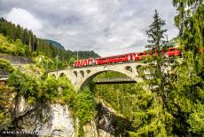 Rhaetian Railway, the Albula and Bernina Lines - Rhaetian Railway in the Albula / Bernina Landscapes: The Solis Viaduct was constructed in 1902 for the Rhaetian Railway. The...