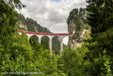 Rhaetian Railway, the Albula and Bernina Lines - Rhaetian Railway in the Albula / Bernina Landscapes: A train on the Landwasser Viaduct outside Filisur. The Landwasser Viaduct is the most...