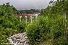 Rhaetian Railway, the Albula and Bernina Lines - Rhaetian Railway in the Albula / Bernina Landscapes: The Glacier Express crossing over the Schmittentobel Viaduct. The Schmittentobel Viaduct...