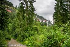 Rhaetian Railway, the Albula and Bernina Lines - Rhaetian Railway in the Albula / Bernina Landscapes: The single-track Landwasser Viaduct. The 65 meters high Landwasser Viaduct is the most...
