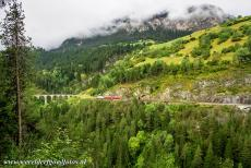 Rhaetian Railway, the Albula and Bernina Lines - Rhaetian Railway in the Albula / Bernina Landscapes: A train passes through the tunnel between the Schmittentobel Viaduct and the Landwasser...