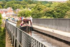 Pontcysyllte Aqueduct - A narrowboat on the Llangollen Canal and Pontcysyllte Aqueduct. It is also possible to walk across the Pontcysyllte Aqueduct.