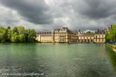 Palace and Park of Fontainebleau - Palace and Park of Fontainebleau: Behind the Carp Lake lies the Cour de la Fontaine. The Carp Lake was a swamp and was turned into a lake under...