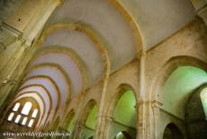 Cistercian Abbey of Fontenay - Cistercian Abbey of Fontenay: The 12th century Romanesque church of the abbey. The sunlight creates beautiful colour contrasts between the lightly...