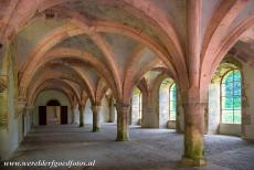 Cistercian Abbey of Fontenay - Cistercian Abbey of Fontenay: The light shining through the stained glass windows gives the Commom Room a gentle pink glow. The first part of the...