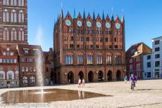 Historic Centre of Stralsund - Historic Centre of Stralsund: The decorative facade of the Old Town Hall, built in the brick Gothic style. The fountain on the Old Market Square...