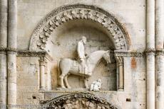 Saint Hilaire Church in Melle - Saint Hilaire Church in Melle: The north entrance door, the horseman is a crowned rider whose horse tramples a seated figure wearing a long robe.