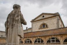 City of Bath - City of Bath: The stone statue of the Roman Emperor Vespasian overlooking the Roman Baths, the upper terrace that surrounds the...