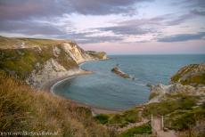 Dorset and East Devon Coast - The Dorset and East Devon Coast: The Man O' War Cove at sunset, viewed from the South West Coast Path. The Man O' War Cove is a small...