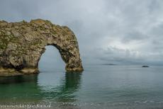 Dorset and East Devon Coast - The Dorset and East Devon Coast: The iconic natural rock arch of Durdle Door at high tide on a misty morning. The Dorset and East Devon Coast also...
