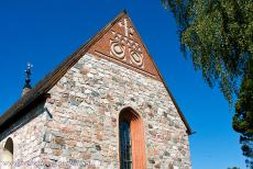 Church Village of Gammelstad, Luleå - Church Town of Gammelstad, Luleå: The east gable of the Nederluleå Church with a brick relief and a loop-hole. The...