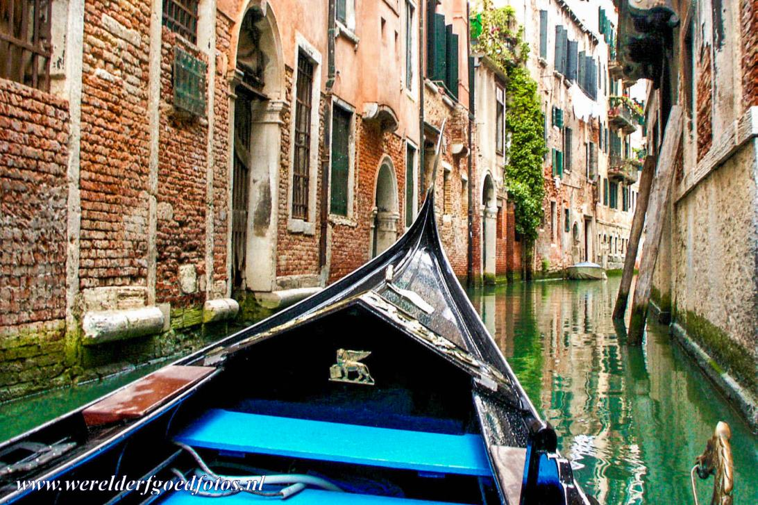 Venice and its Lagoon - Venice and its Lagoon: A gondola sailing on a narrow canal. For centuries, the gondola was the main form of transportation in Venice, they...