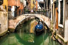 Venice and its Lagoon - Venice and its Lagoon: A gondola on a narrow canal in Venice. The first gondolas were used in Venice in the 11th century. A 16th century Venetian...