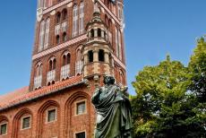 Medieval Town of Torun - Medieval Town of Toruń: The Copernicus Monument in front of the Toruń Old Town Hall. The Toruń Old Town Hall dates back to the end of the 14th...