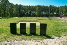Auschwitz - Birkenau - Auschwitz - Birkenau German Nazi Concentration and Extermination Camp (1940-1945): The four black memorial stones at one of the ash ponds of...