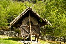 Rock Drawings in Valcamonica - Rock Drawings in Valcamonica: A hut, constructed like the ones engraved on the rocks. The rock engravings in Valcamonica has been made...