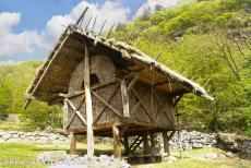 Rock Drawings in Valcamonica - Rock Drawings in Valcamonica: A reconstructed hut like the engraved huts on the rocks. Valcamonica is a valley in northern Italy....